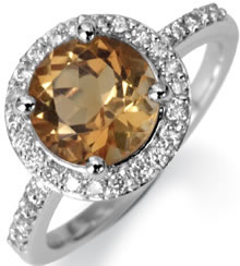 large diamond ring with smaller diamond surround set in platignum